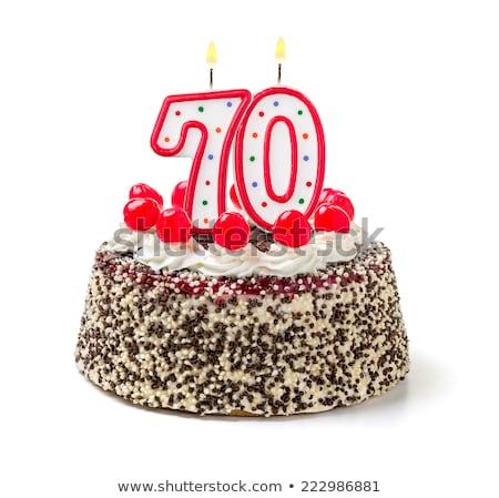 Birthday cake with burning candle number 70 Stock photo © Zerbor