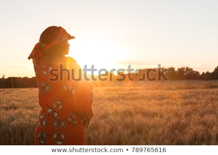 African woman at sunset Stock photo © adrenalina