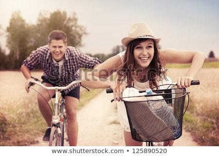 brunette · fiets · handen · ogen · natuur · groene - stockfoto © geribody