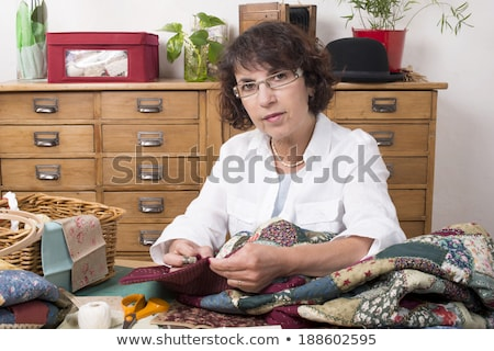 Portrait Of Woman Sewing Quilt At Home Stock photo © HighwayStarz