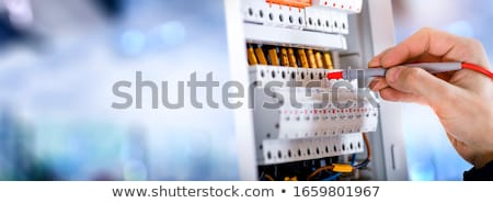 Hand Testing Electrical Board Stock photo © AndreyPopov