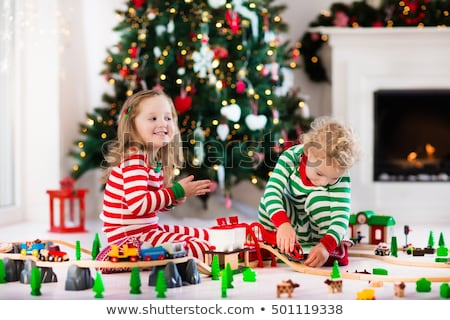 Little boy in Christmas, playing with new toy car Stock photo © icefront