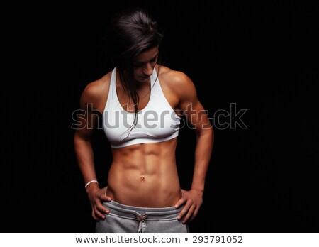 női · fitnessz · testépítő · pózol · fehér · nő - stock fotó © wavebreak_media