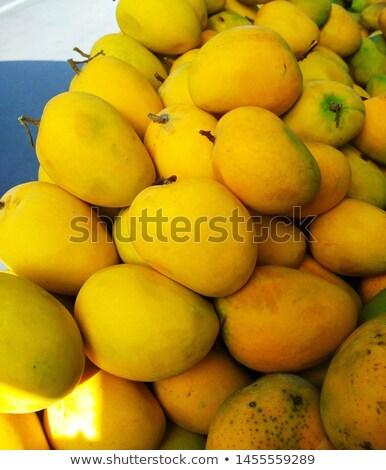 Fresh juicy mango on the market in India Goa Stock photo © mcherevan
