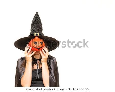 Pretty brunette hiding behind her hands Stock photo © wavebreak_media