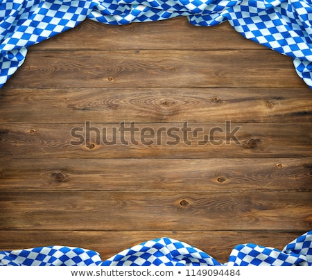 a wooden background with a bavarian tablecloth stock photo © zerbor