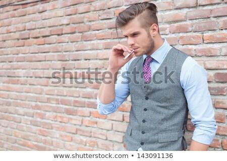Casuale uomo sigaretta adulto bocca fumo Foto d'archivio © stevanovicigor