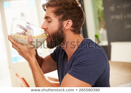 Junger Mann hungrig Studio Foto Mann isoliert Stock foto © filipw