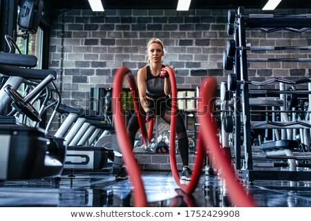 привлекательный вверх Теннисная ракетка женщину Сток-фото © filipw