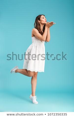 sevimli · genç · kadın · kıvırcık · saçlı · öpücük · gri - stok fotoğraf © deandrobot