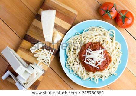 Gruyere cheese with pasta press and spaghetti Stock photo © ozgur