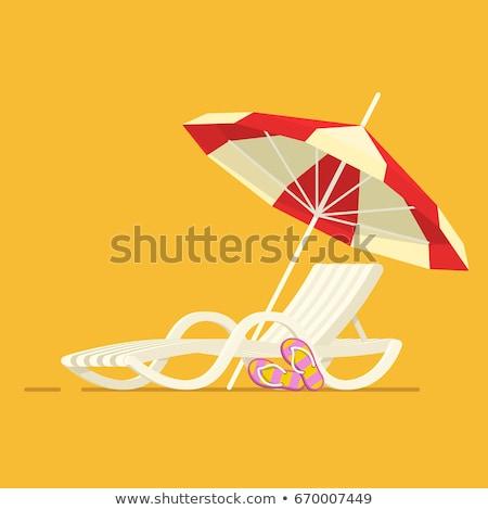Woman in sun lounger resting on beach Stock photo © Kzenon