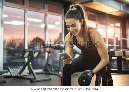 Фитнес-женщины · сидят · спортзал · прослушивании · музыку - Сток-фото © deandrobot