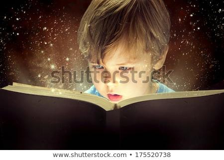 Kid reading book, light in darkness Stock photo © zurijeta