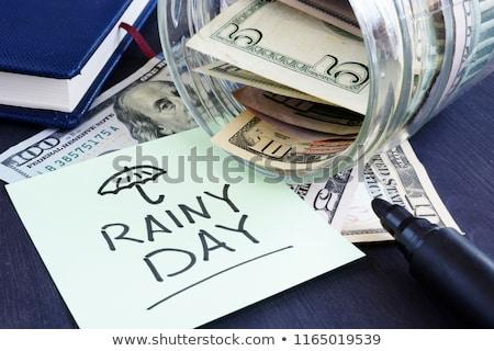 Pluies jour fonds tirelire argent Photo stock © Lightsource