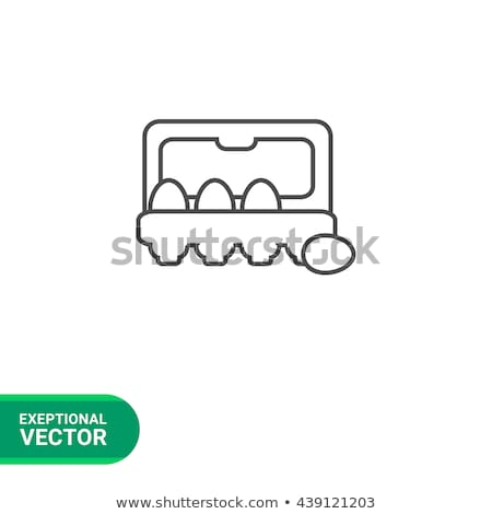 Stock photo: Eggs in carton package line icon.