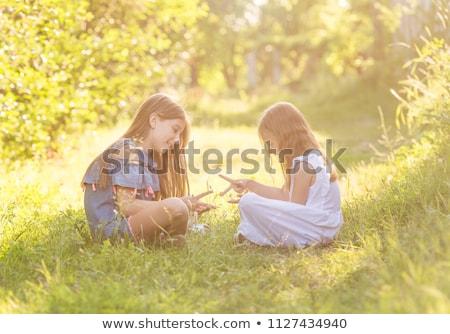 Iki oynama taşlar kızlar oynamak Stok fotoğraf © superelaks