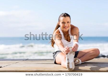 nő · nyújtás · lábak · jóga · testmozgás · fitnessz · nő - stock fotó © deandrobot
