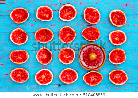 Rows of freshly squeezed ruby grapefruit halves Stock photo © ozgur