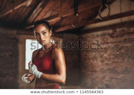Sportoló pózol törölköző mosolyog kamera egészséges életmód Stock fotó © stokkete