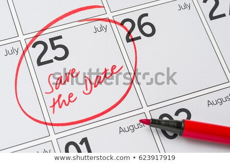 save the date written on a calendar   july 25 stock photo © zerbor