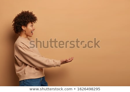 Teenage girl pretending to be holding invisible object Stock photo © wavebreak_media