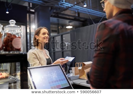 happy man with cash money paying at cafe Stock photo © dolgachov