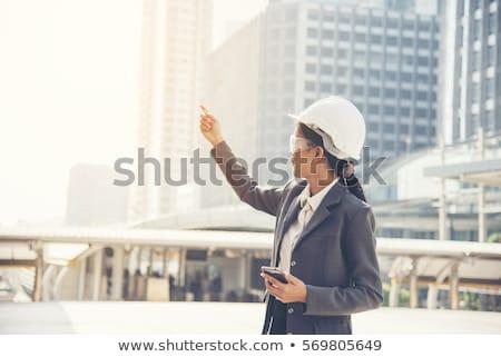 trabalhando · escritório · feminino · estilista · sorridente · câmera - foto stock © is2