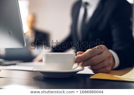 młody · człowiek · tabeli · biuro · pióro · strony · komputera - zdjęcia stock © deandrobot