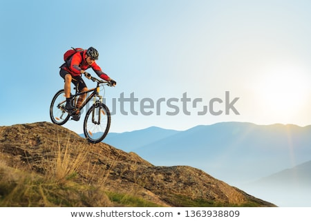 Mountain biker riding down a hill. Stock photo © IS2