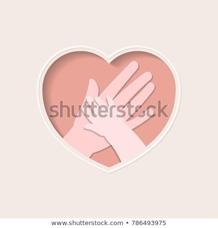 forma · de · coração · mãos · em · torno · de · vermelho · amor · mulher - foto stock © is2