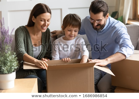 Boy unpacking glasses from box Stock photo © IS2