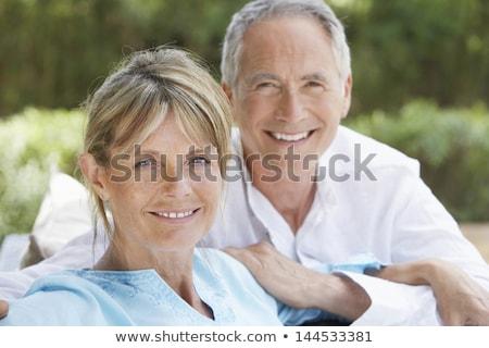 pár · kint · dől · korlát · mosolyog · nő - stock fotó © is2