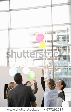 Business team sets colored balloons free Stock photo © IS2