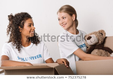 Woman packing teddy bear in a box Stock photo © IS2