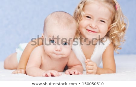 Girl smiling with baby sister Stock photo © IS2