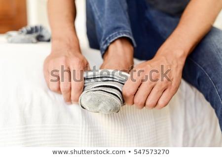 Man sokken bed leuk portret lachend Stockfoto © IS2