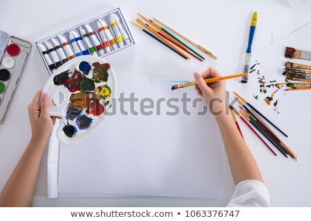 Elevated View Of Artist Painting On Canvas Paper Stock photo © AndreyPopov