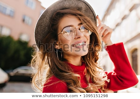 Portrait closeup of glad smiling woman with brown curly hair, re Stock photo © deandrobot
