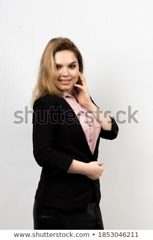 Foto mujer sonriente blanco camisa negro falda Foto stock © deandrobot