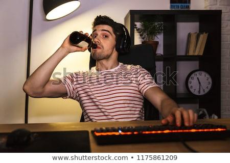 Сток-фото: портрет · кавказский · парень · наушники · питьевой