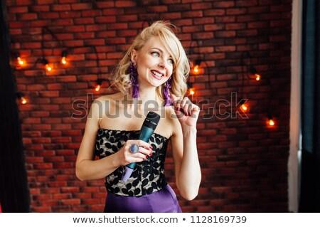 красивая девушка ведущий микрофона улыбаясь музыку Сток-фото © ruslanshramko