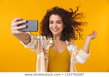 Photo closeup of european woman 20s with curly hair smiling and  Stock photo © deandrobot