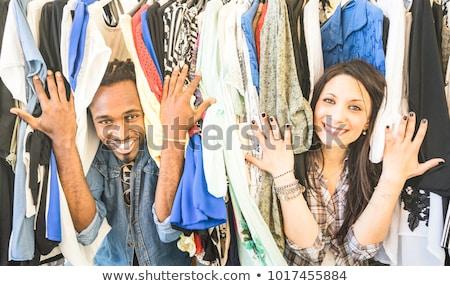 Feliz casal vintage roupa armazenar cabide Foto stock © dolgachov