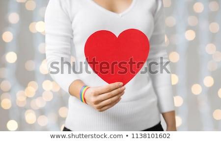 Nő homoszexuális tudatosság karszalag tart szív Stock fotó © dolgachov