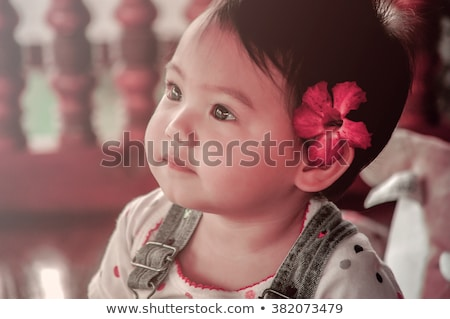 happy beautiful baby girl with pink flower on head stock photo © svetography