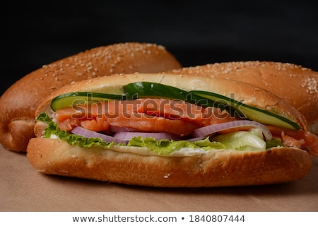 fresh healthy salmon sandwich with lettuce and cucumber with paper cup of coffee on white stone back stock photo © denismart