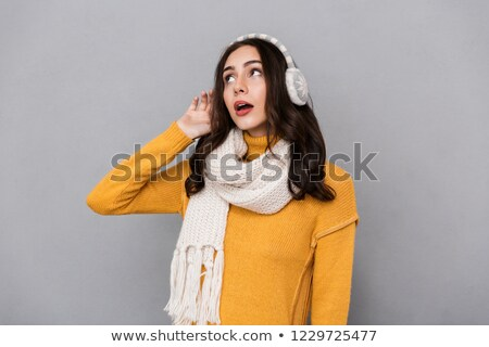 Portrait of european woman wearing ear muffs and scarf looking a Stock photo © deandrobot