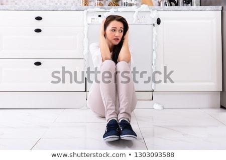 Zdenerwowany kobieta posiedzenia uszkodzony zmywarka piana Zdjęcia stock © AndreyPopov