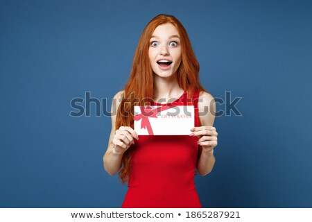 Elegant woman looking at camera and keeping present Stock photo © studiolucky